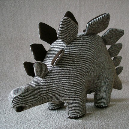I adore this stegosaurus, handmade from men's suiting material.  What a great gift for a kid, or kid at heart.    Etsy :: catsmiaow :: Handmade Wool Stegosaurus