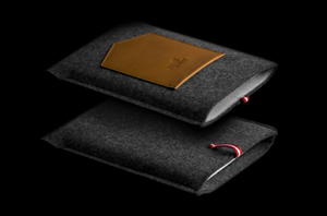 What was previously one of my favorite Etsy shops - Working Class Heroes - is now Hard Graft.  Still selling unreasonably priced but unbelievably well-designed felt and leather cases for all your up-to-the-minute technology.  The fact that they combine two of the worlds' oldest materials with state-of-the-art products is beautiful, as is their craftsmanship.  If only I could afford ANY of it.    hard graft™ - the new working class heroes