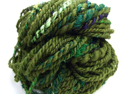 Really great, super bulky yarn.  I really can't wait for my craft room to get set-up so that I can jump back into knitting….and sewing….and all things crafty…    Etsy :: craftyyarn :: SWAMP PRINCESS - handspun recycled yarn