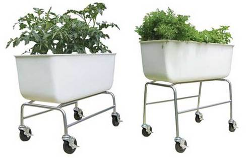 "I really wish we had enough room for one of these.  Similar to a homemade ""salad table"", but deeper to accomodate larger plants, and on wheels! Apartment Therapy Re-Nest 