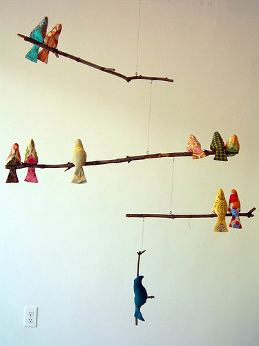 This would be perfect hanging in front of our new large windows.  The birds are all hand-sewn - there is a free pattern download in their sidebar. Spool Sewing » Blog Archive » Bird Mobile
