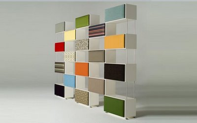 Modular shelving system with changeable front panels that feature Maharam fabrics.  Genius.    Dekast by Michel Doyer Furniture Designs