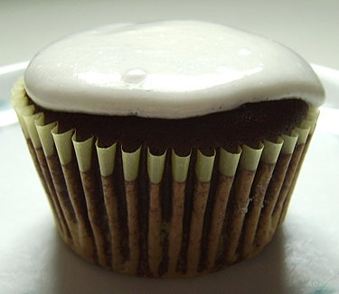 A day late for the festivities, this delicious looking cupcake is made with Guinness.  I'll have to go buy some beer, but I'm excited for this recipe.    via Big City, Little Kitchen - Beer Cupcakes!