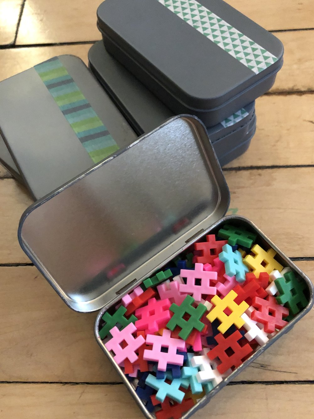 Another tin contained a variety of colors of  Plus Plus blocks . These are a great open play activity for toddlers and up - sorting, building, etc. And an off-brand variety can occassionally be found in the Target dollar aisle.