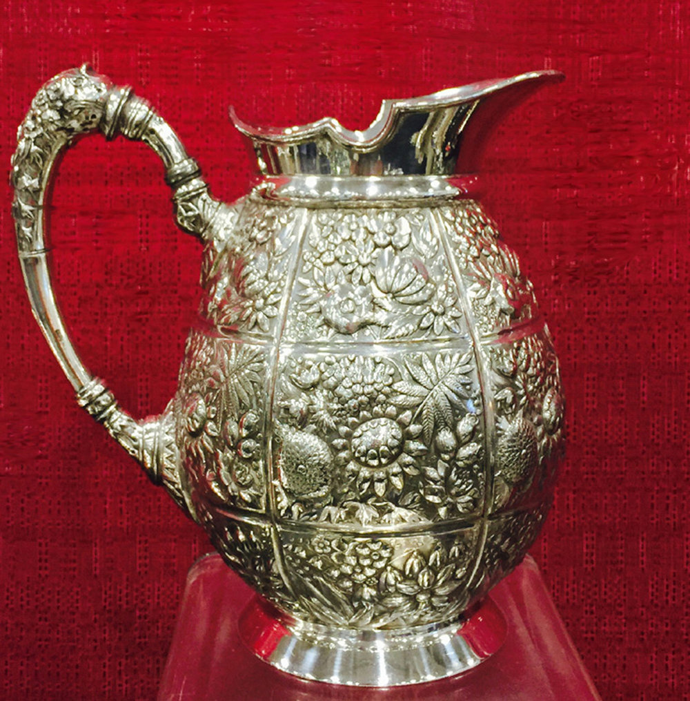 EMBOSSED SILVER PITCHER FOR TV.jpg