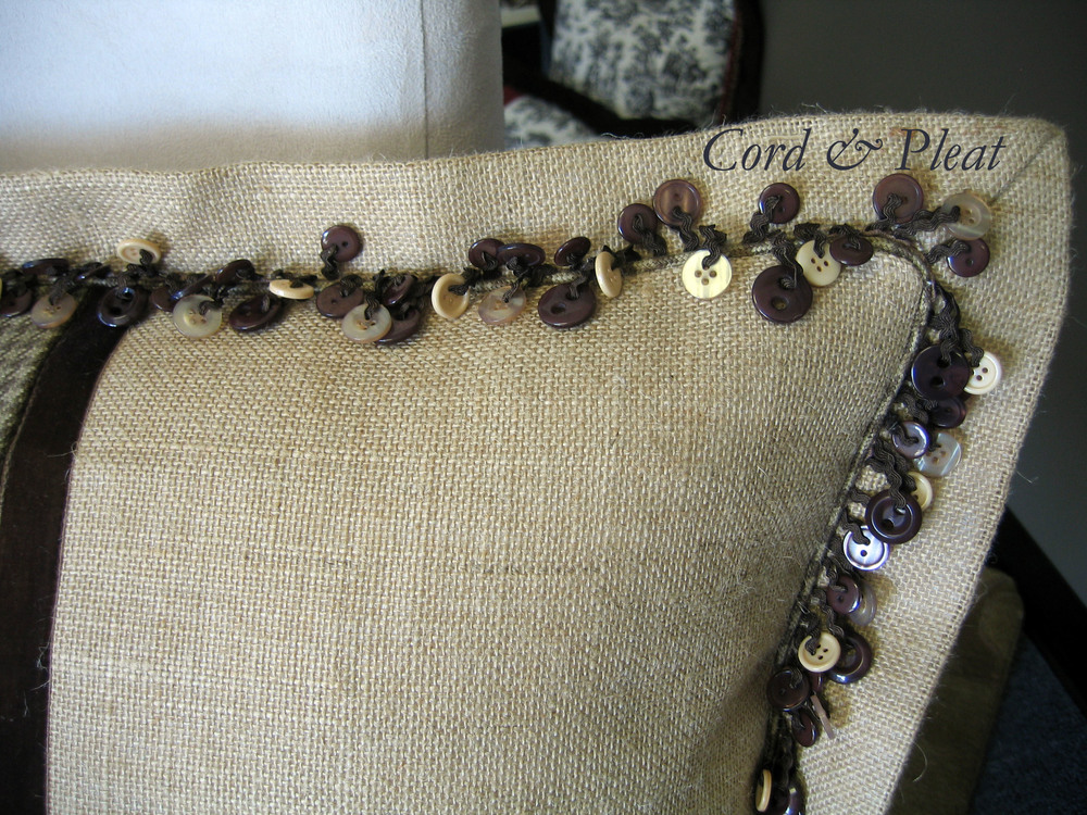 Close up photo of Decorative Trim, Micro-cording & mitered flange on lumbar pillow.