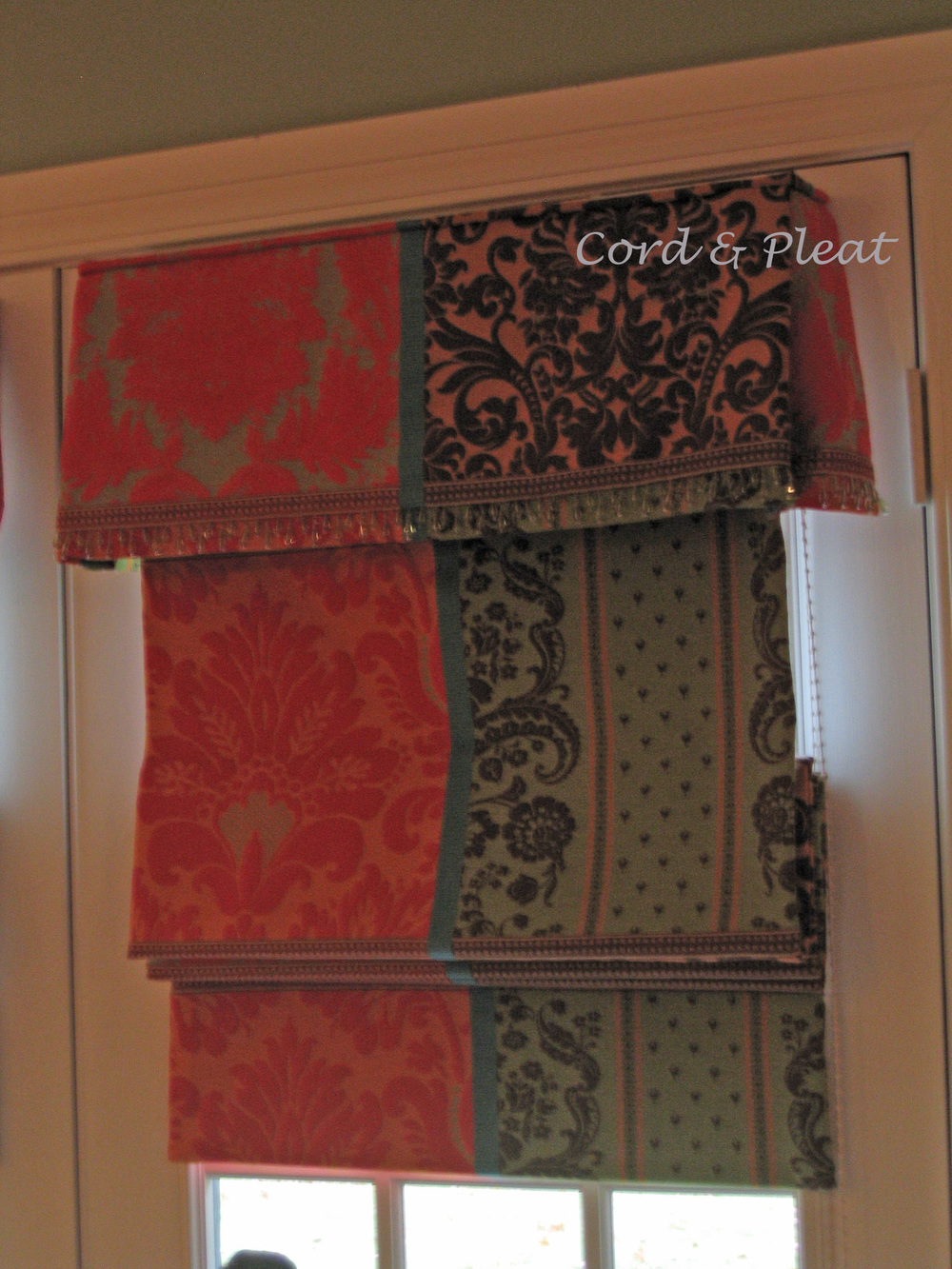 a Flat Roman shade w/Attached Valance; fabricated by Cord & Pleat Design, Inc.