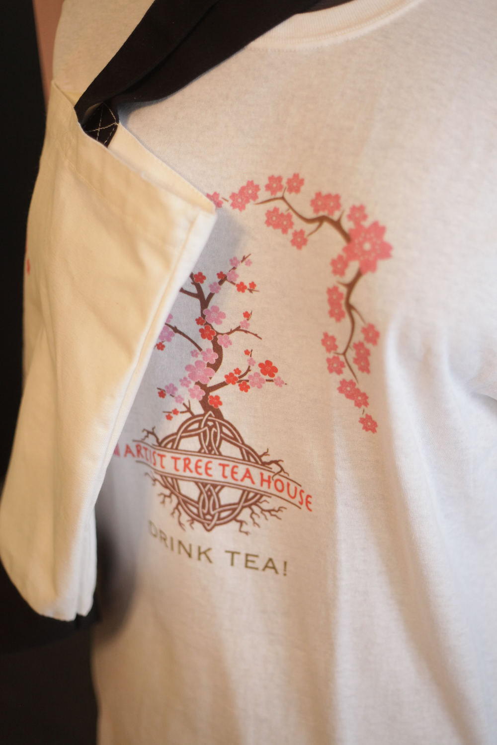 Gift items are for sale including shirts and totes.