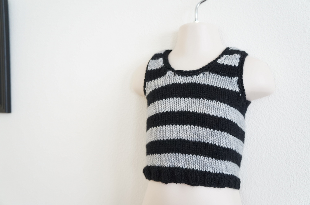 Dior-inspired vest is done in Paton's Classic Wool (Black) and Madelinetosh Tosh Merino (Silver Fox). | Handmade Fashion at Candy + Bagel