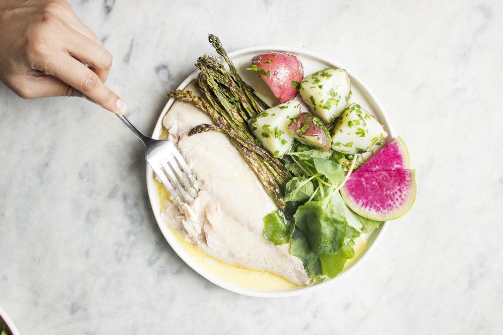 fish plate sauce and hand.jpg