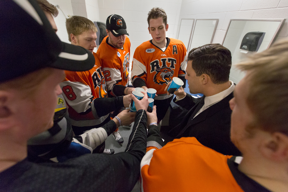 Rochester Institute of Technology men's hockey team defensemen take shots of gatorade with Dave Insalaco, assistant coach of RIT, before a semifinal Atlantic Hockey Conference hockey game against Canisius College at Blue Cross Arena on March 20, 2015 in Rochester, N.Y.