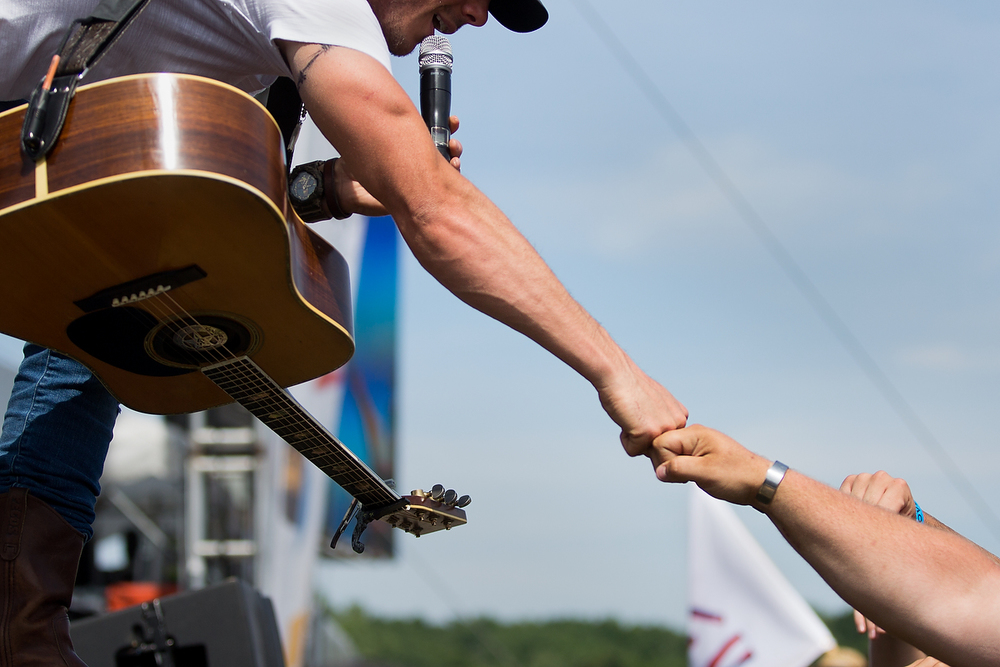 Granger Smith give knuckles to a fan while performing at B-93 Birthday Bash 24 at US 131 Motorsports Park in Martin, Mich. on Saturday, June 18, 2016. (Bryan Bennett / Kalamazoo Gazette)