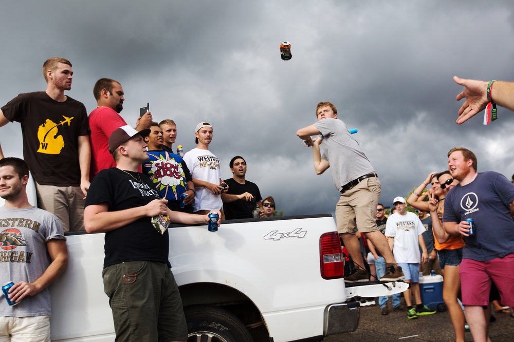 Fans play a game during a tailgate at Western Michigan University before WMU takes on North Carolina Central at Waldo Stadium in Kalamazoo, Mich., Saturday, Sept. 10, 2016. (Bryan Bennett | MLive.com)