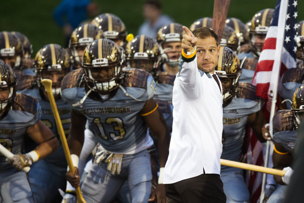 Western Michigan Broncos head coach P.J. Fleck leads the team to the field for the battle of the Victory Cannon at Kelly/Shorts Stadium in Mt. Pleasant, Mich. on Saturday, Oct. 1, 2016. WMU defeated CMU 49-10 and remains undefeated at 5-0 as CMU falls to 3-2. (Bryan Bennett | MLive.com)