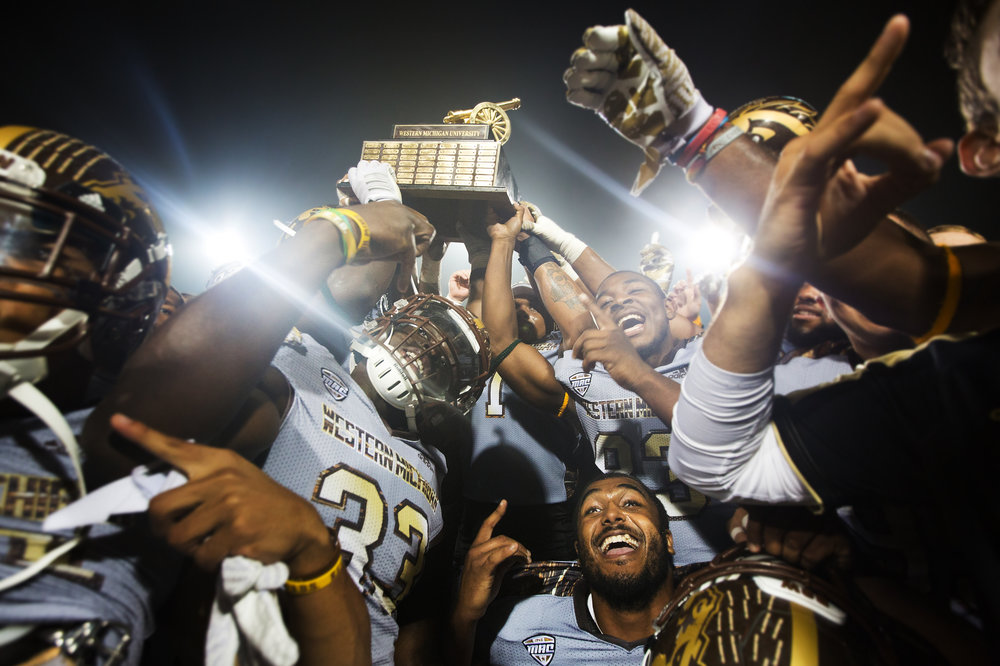 Western Michigan Broncos celebrate with the Victory Cannon trophy at Kelly/Shorts Stadium in Mt. Pleasant, Mich. on Saturday, Oct. 1, 2016. WMU defeated CMU 49-10 and remains undefeated at 5-0 as CMU falls to 3-2. (Bryan Bennett | MLive.com)