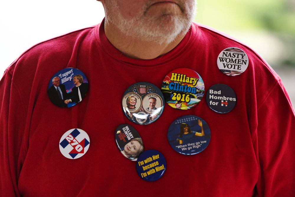 Ken Hosner, of Kalamazoo, sells buttons before Sen. Bernie Sanders speaks while campaigning for presidential nominee Hillary Clinton at Miller Auditorium on Western Michigan University's campus in Kalamazoo, Mich., Wednesday, Nov. 2, 2016. Horner has been selling buttons since 1968. (Bryan Bennett | MLive.com)