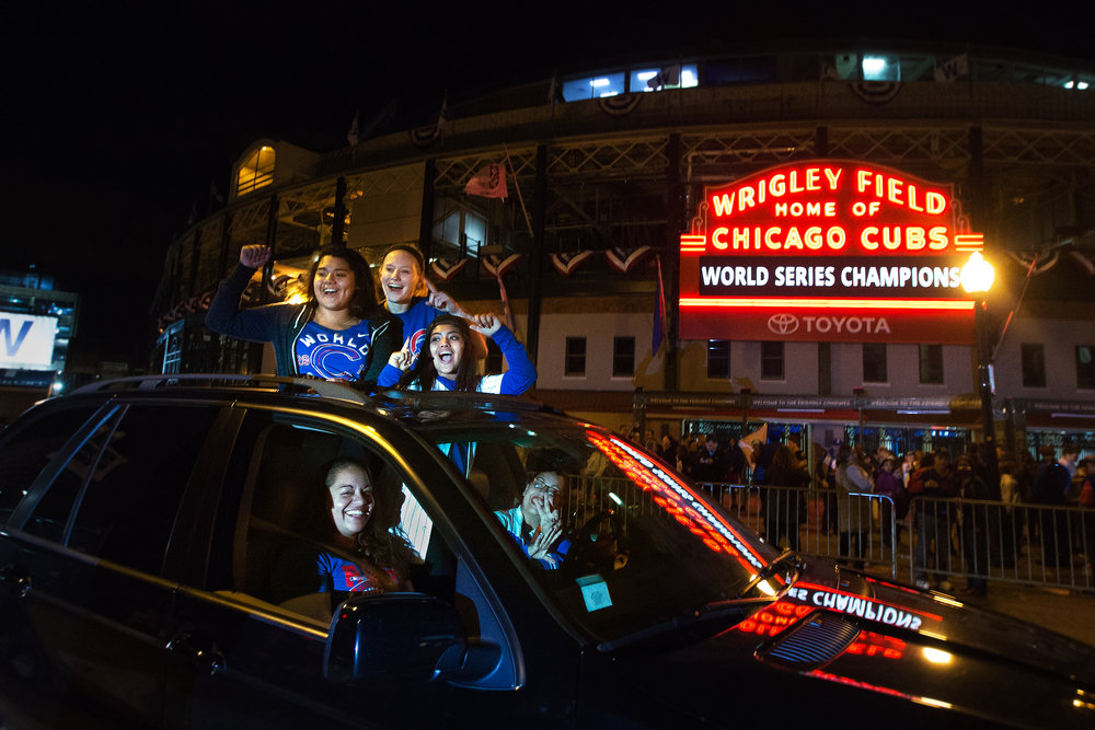 Fans celebrate while at the intersection of N. Clark St. and W. Addison St. outside of Wrigley Field in Chicago, Friday, Nov. 4, 2016.