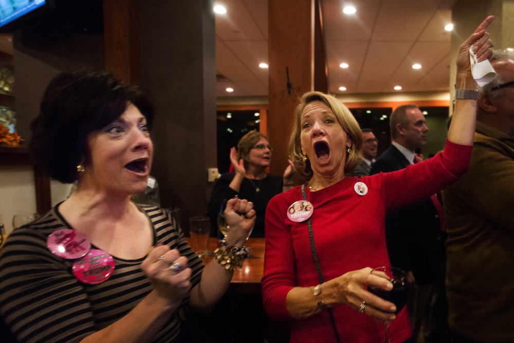 Bonnie Wedel, left, and Ruth Wiser, right, both of Kalamazoo, react after Donald Trump is announced the projected winner of Ohio at a Republican watch party at Fieldstone Grill, Tuesday, Nov. 8, 2016 in Portage, Mich. (Bryan Bennett | MLive.com)