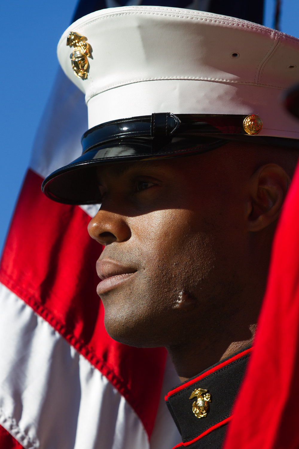 SSgt. Austin Leon, of Marine Corps Reserve Center in Battle Creek, Mich., listens during the Kalamazoo County Veterans Day Ceremony at Rose Park Veterans Memorial in Kalamazoo, Mich., Friday, Nov. 11, 2016. (Bryan Bennett | MLive.com)