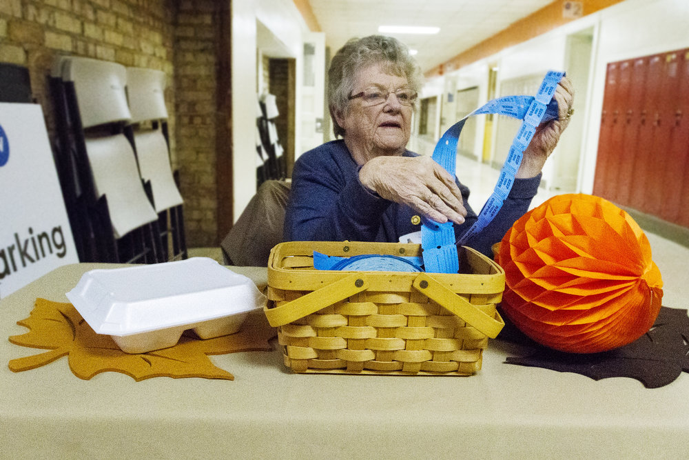 Susan Erion, of Paw Paw, counts tickets during the 32nd annual Paw Paw Community Thanksgiving Dinner at Freshwater Community Church in Paw Paw, Mich., Thursday, Nov. 24, 2016. Over 600 pounds, or 38 turkeys, were smoked for the annual dinner. (Bryan Bennett | MLive.com)