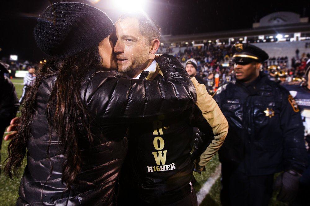Western Michigan Broncos head coach P.J. Fleck is kissed by his wife Heather Fleck after a NCAA college football game against Toledo at Waldo Stadium in Kalamazoo, Mich., Friday, Nov. 25, 2016. WMU defeated Toledo 55-35 to advance to the Mid-American Conference championship at Ford Field in Detroit on Dec. 2. (Bryan Bennett | MLive.com)