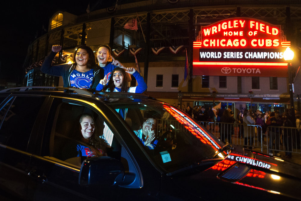 Chicago Cubs fans celebrate the team winning the World Series while at the intersection of N. Clark St. and W. Addison St. outside of Wrigley Field in Chicago, Friday, Nov. 4, 2016.
