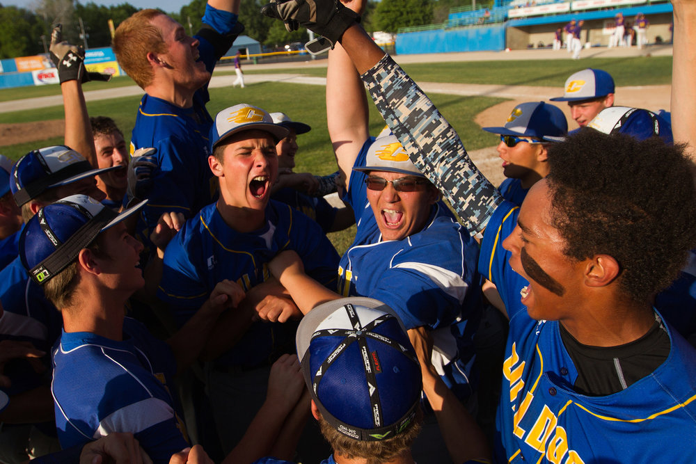 Centreville players celebrate after defeating Concord 4-3 during the Michigan High School Athletic Association Division 4 quarterfinal game at C.O. Brown Stadium in Bailey Park in Battle Creek, Mich. on Tuesday, June 14, 2016. Centreville advance to the semifinal game and were defeated by Parkway Christian 5-1.