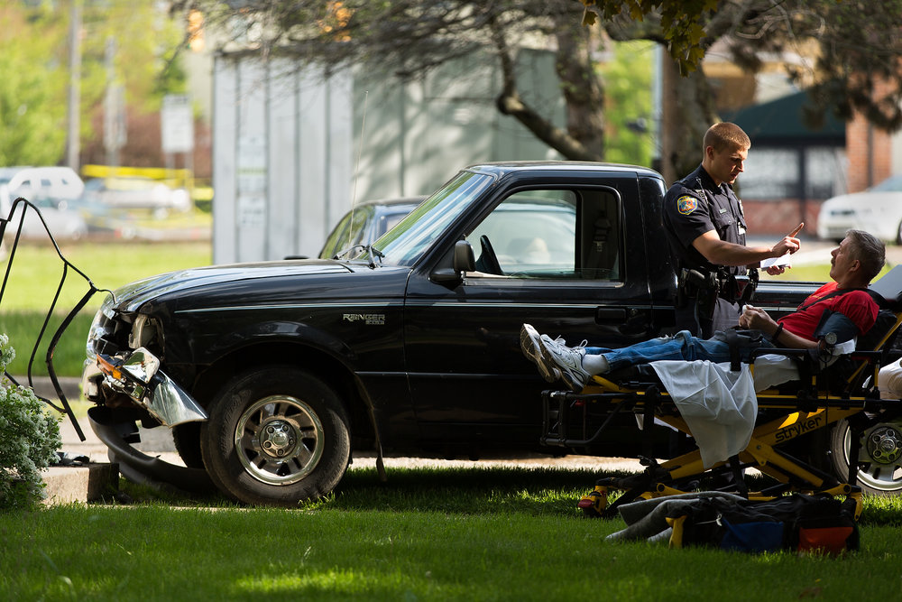 An officer gives a man a sobriety test at 208 Elm St. after a vehicle ran into the front of the home in Kalamazoo, Mich. on Monday, May 16, 2016. The man was taken to the hospital under protocol and authorities confirmed alcohol was involved.