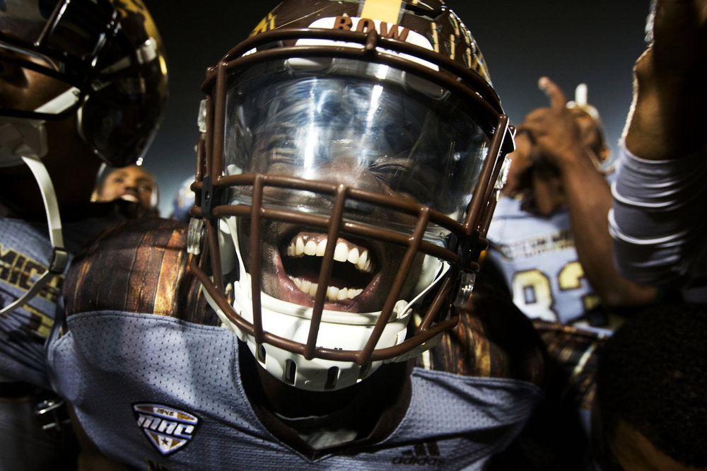 Western Michigan Broncos running back Leo Ekwoge (33) smiles for the camera after the battle of the Victory Cannon at Kelly/Shorts Stadium in Mt. Pleasant, Mich. on Saturday, Oct. 1, 2016. WMU defeated CMU 49-10 and remains undefeated at 5-0 as CMU falls to 3-2.
