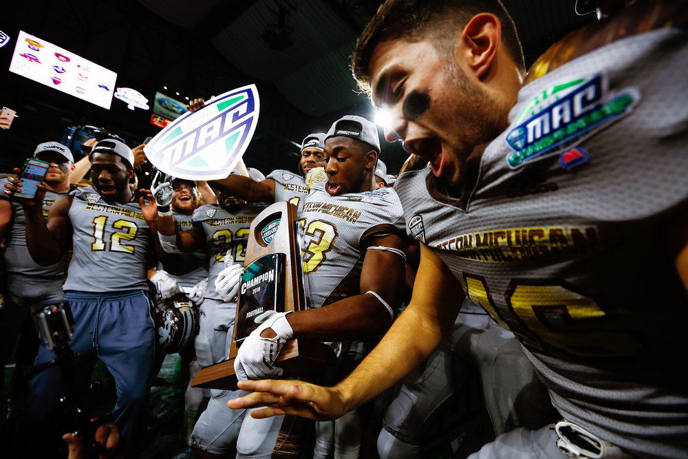 Western Michigan Broncos celebrate after defeating the Ohio Bobcats  29-23 in the NCAA Mid-American Conference championship game at Ford Field in Detroit, Friday, Dec. 2, 2016. (Bryan Bennett | MLive.com)