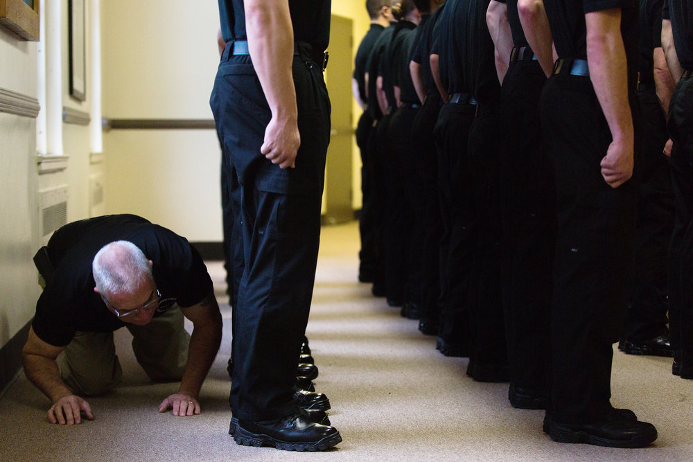 Chief David Amico, left, checks for mud on cadets boots during uniform inspection at the Phase I Pre-Employment Police Basic Training Program at Cazenovia College on Dec. 5, 2015 in Cazenovia, N.Y. Cazenovia College�s Phase I Pre-Employment Police Basic Training Program began in September and will conclude in June 2016. Upon graduating from the program, cadets will receive a certificate indicating completion of the program. The certificate gives the cadets two years to find full time employment in a police department, complete Phase II of the training, before receiving the full basic school certificate from the Department of Criminal Justice.