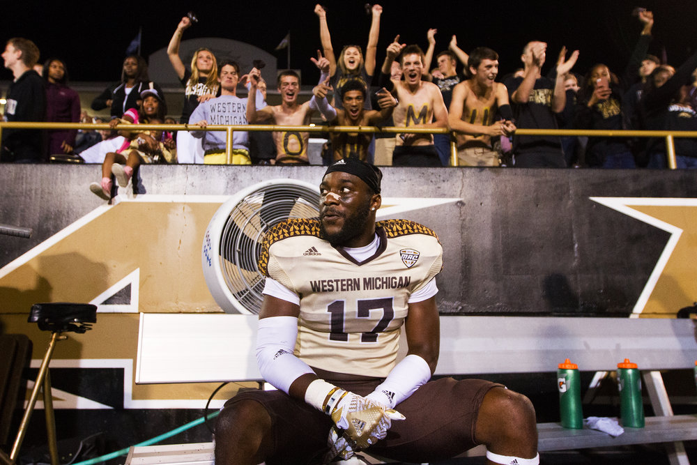 Western Michigan Broncos safety Justin Ferguson (17) sits on the bench after securing a win for the Broncos with an interception with a minute left in the game against Georgia Southern on Sept. 24, 2016.