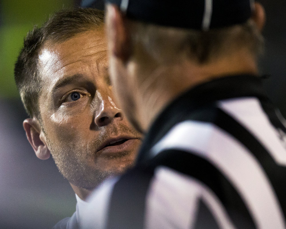 Broncos head coach P.J. Fleck speaks with a ref during the first half against Georgia Southern on Sept. 24, 2016. WMU defeated Georgia Southern 49-31.