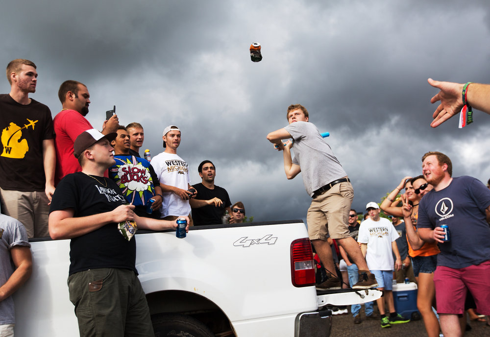 Fans play a game during a tailgate at Western Michigan University before WMU takes on North Carolina Central at Waldo Stadium in Kalamazoo, Mich., on Sept. 10, 2016.