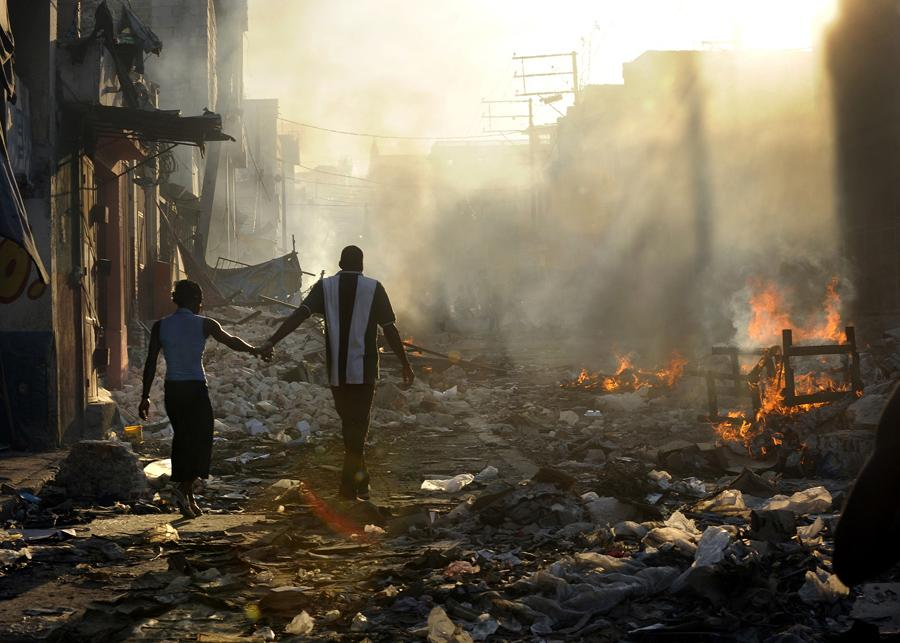 'Life Amid the Ruins' A couple holds hands and walks amid the wreckage of their country's wounded landscape. Experts familiar with the rebuilding efforts in Haiti say relief work is finally speeding up under the guidance of the Interim Haiti Recovery Commission. The group has set a goal of removing 40 percent of the earthquake rubble by October and has approved projects such as highways, apartment buildings and 250 temporary schools for children. But even with these projects underway, rebuilding Haiti will take many years. (Carol Guzy, The Washington Post)