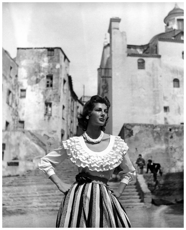 Fiona Campbell-Walter in skirt and ruffled blouse by Christian Dior, Corsica, photo by Georges Dambier, Nouveau Femina, June 1954