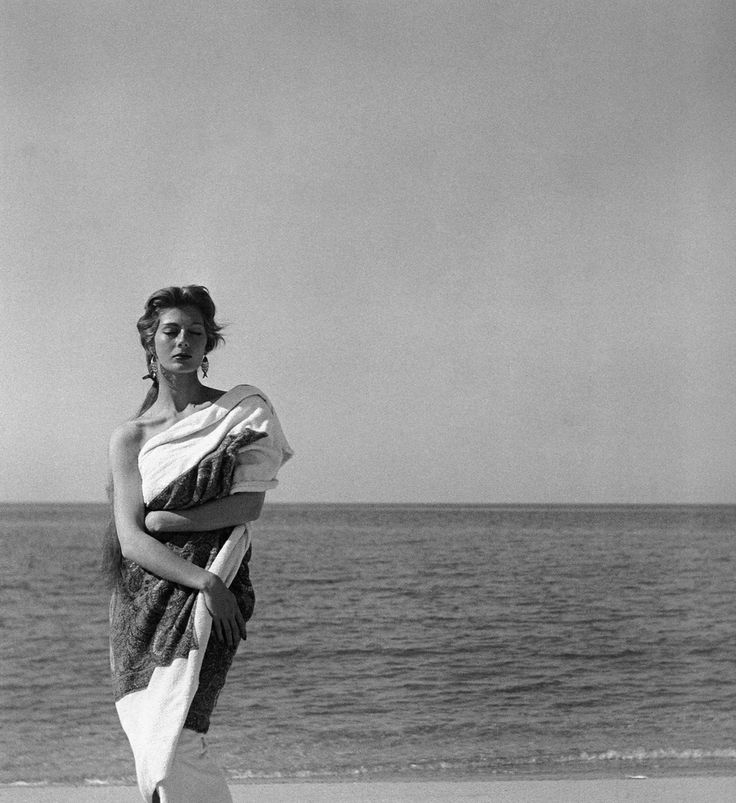 Fiona Campbell-Walter draped in cashmere beach towel by Givenchy, Corsica, photo by Georges Dambier, Nouveau Femina, June 1954
