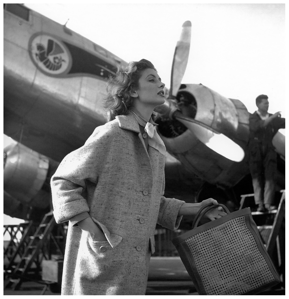 Suzy Parker in a tweed coat with kimono sleeves by Jamica, Morocco, ELLE April 27, 1953  by Georges Dambier