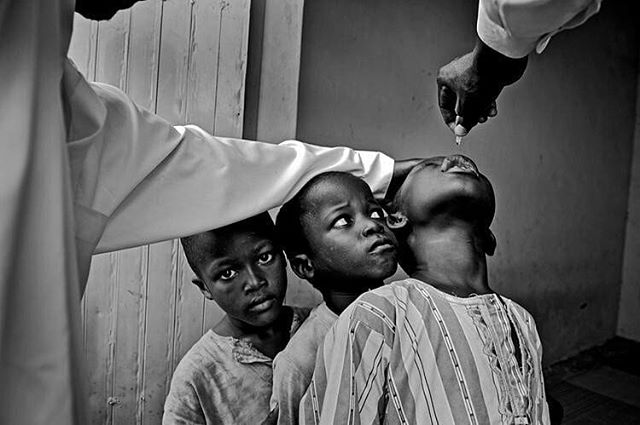 Nigeria's Polio Nightmare: Kano, Nigeria Boys wait their turn for two drops of polio vaccine. Taken by Mary F. Calvert, published by The Washington Times. She is currently a freelance photographer and we recommend you check out her incredible projects @maryfcalvert! ⠀ ⠀