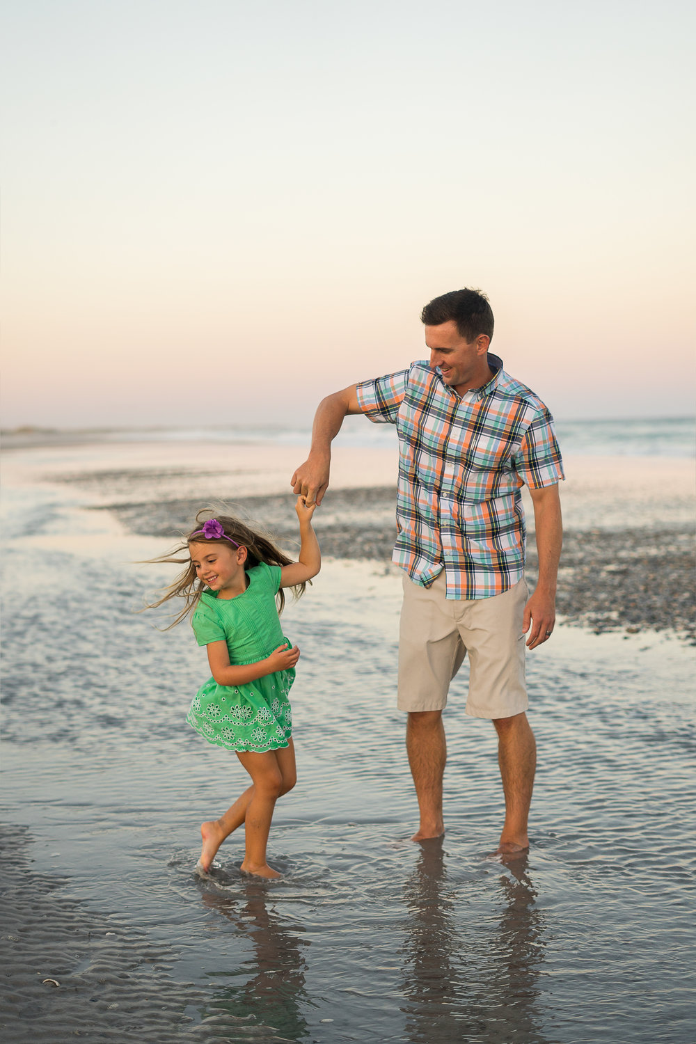 Dancing feet in the sand and surf. Father daughter moments are some of my favorites.