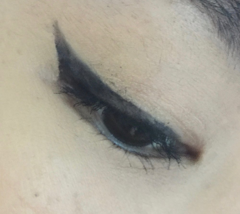 Since the eyeliner's ink wasn't consistent from the tip, I wasn't able to fill in my line perfectly well