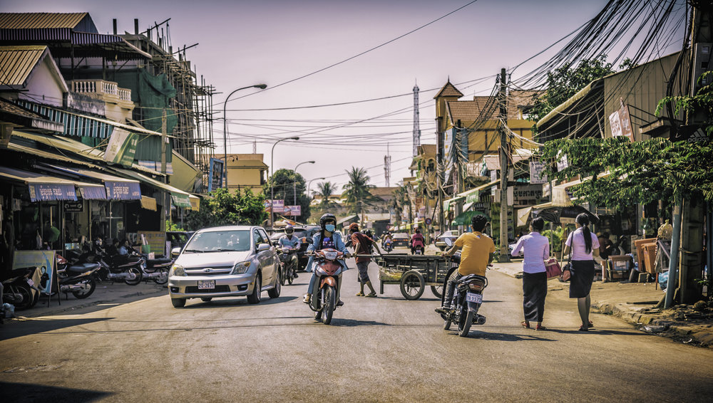 This kind of street scene plays out all over Southeast Asia. The tangle of electrical wires above ground, as different people tap into the grid both legally and illegally. In this case, things actually look pretty organized compared to some other cases. 