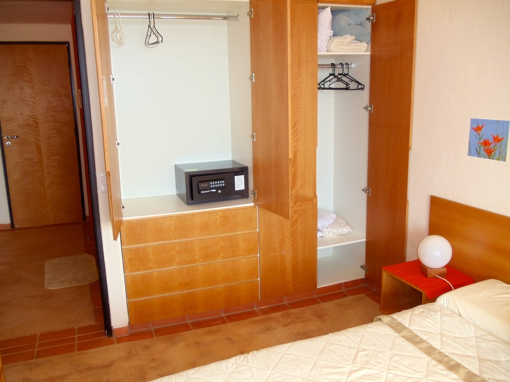 Alegria - bedroom closet with safety box