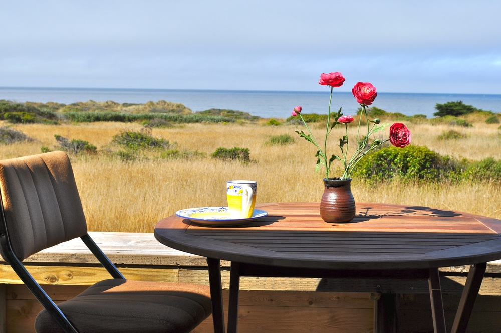 Whether you want to watch the dunes and the ocean from the private front deck of Casa Pacis .....