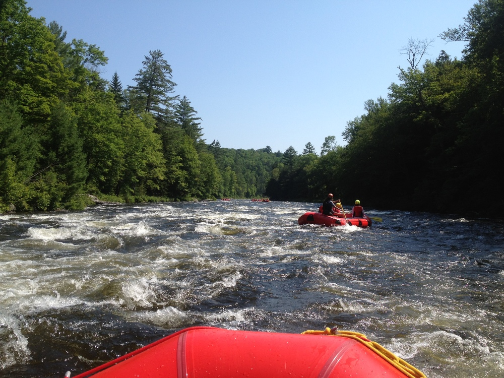 Whitewater rafting class III rapids on North Creek River.