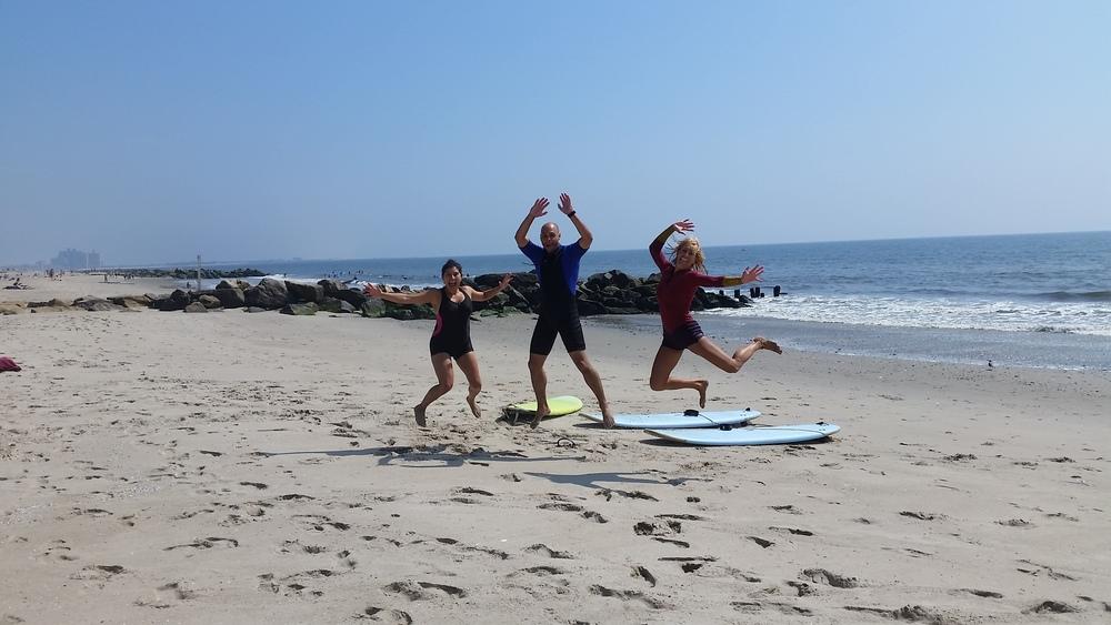 Post-surfing excitement on Rockaway Beach
