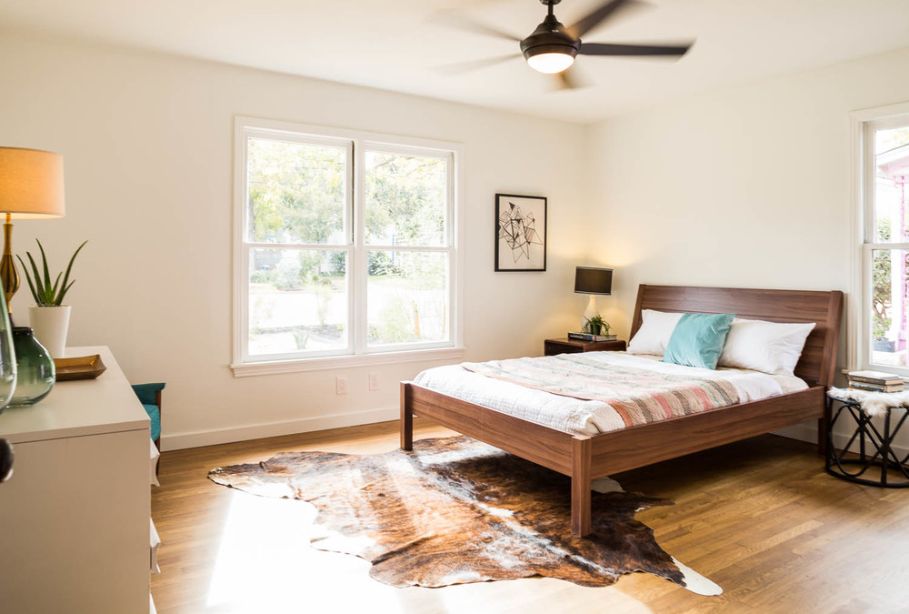 cherrywood austin mid century modern bedroom with cowhide rug ikea nyvoll bed