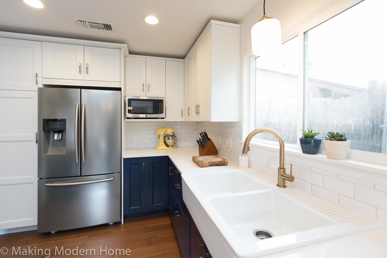 Budget Friendly Navy, White, and Brass Kitchen — making modern home