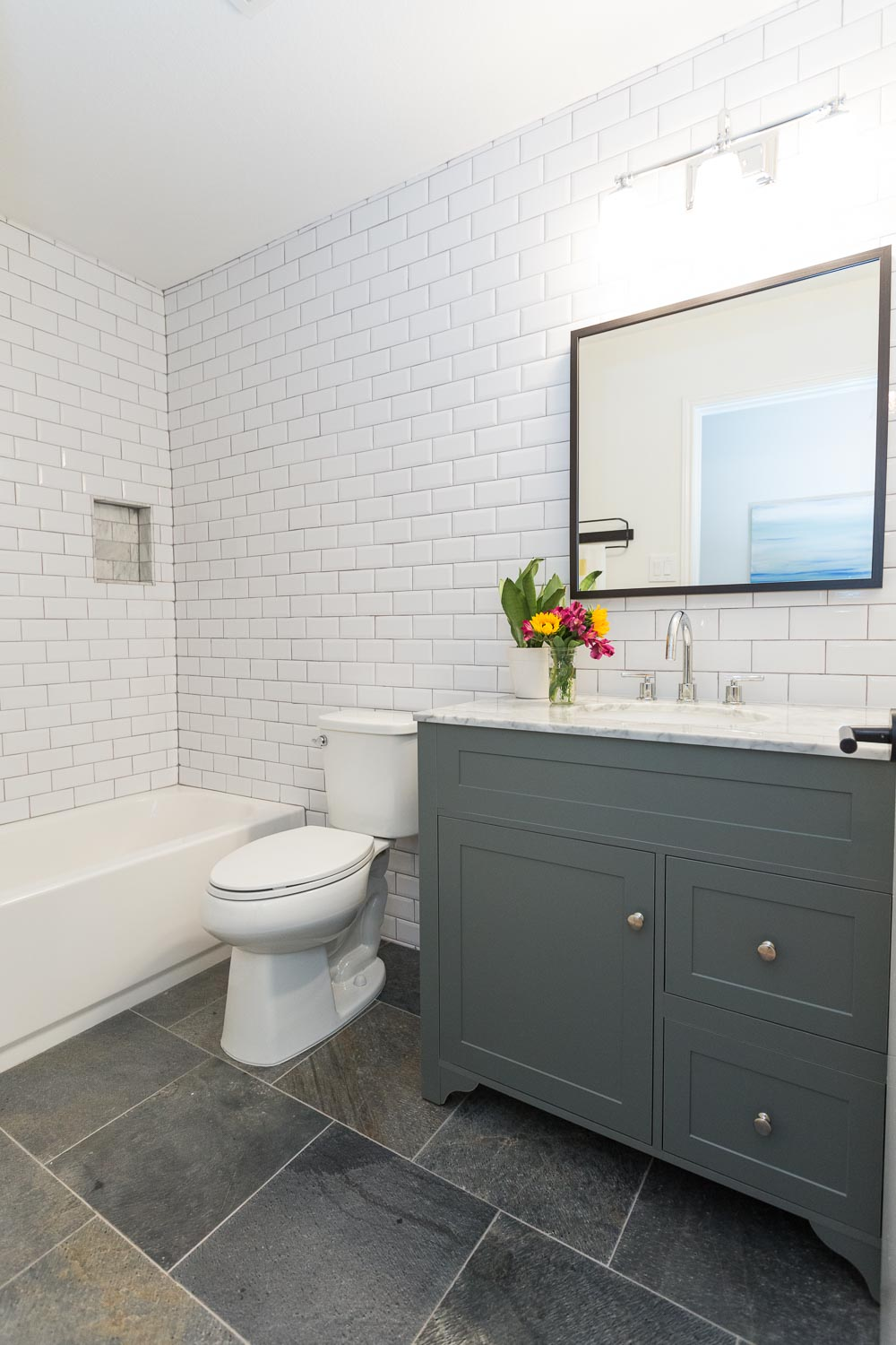 East austin modern farmhouse just completed making modern home white subway tile with gray grout slate quartzite floors modern gray vanity with carrara dailygadgetfo Choice Image