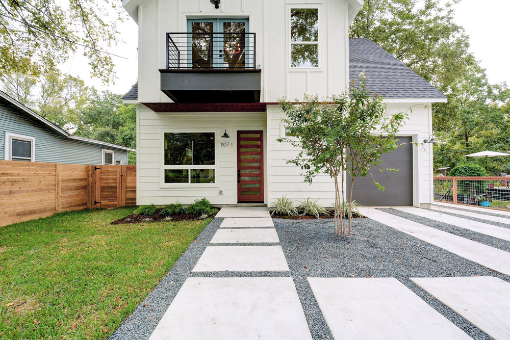 "The charming Modern Cottage architecture is perfect for a white color scheme with wood accents. The modern front door and balcony contrast the barn lights. The french doors are painted Benjamin Moore Seastar and the garage door is my go-to Sherwin Williams ""Urbane Bronze""."
